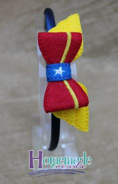 Lady Wonder Hero Embroidered Felt Bow for your favorite comic book hero fan! Bow measures 4 x 1.5. Choose between an alligator clip, french barrette, stretch headband sized to fit any size you like or a flexible hard headband that comfortably fits toddlers through adult. Please review shipping and policies as all items in my shop are made to order and have a longer processing time, thank you! Every piece from Homemade Trends is handmade with love in a smoke free home. Please visit me on…