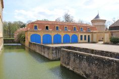 chateau-de-la-grange- the moat is still in use around le chateau & some of the out buildings
