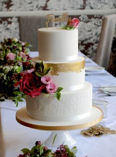 Gold leaf, piped lace and sugar flowers wedding cake