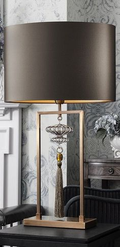 Classy Table Lamp with Brass, crystal and tassel   Find more amazing lighting http://www.bocadolobo.com/en/products/lighting.php