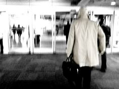 Telly Savalas at the airport by monkeyseemonkeypoo, via Flickr | blue + street scene people + black white tan
