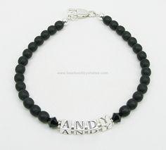 Men's Cancer Awareness Bracelet for Peggy. A Black Crystal next to the name represents Melanoma.