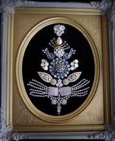 great inspiration - i plan on making jewelry art with my grandmother's costume jewelry, but in shapes other than christmas trees.