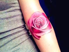 rose tattoo, looks like very little/no black ink.