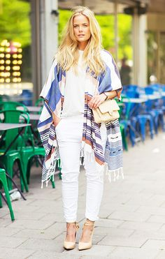 Joanna Fingal in a printed poncho, white t-shirt, white denim, and nude heels