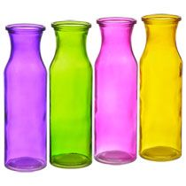 """You will always want to keep fresh flowers around to show off these lovely milk bottle vases. These translucent glass vases stand 7¾"""" tall, measure 1¾"""" at the opening with a tr"""