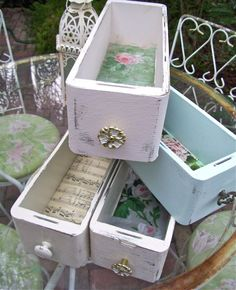 I like the idea of lining the bottom of the drawer with special paper.  I could even be some cute fabric. Great display prop for at a craft fair.