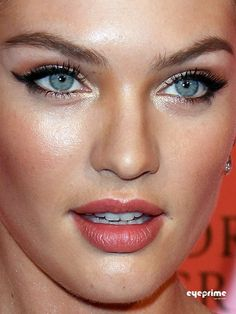 Candice Swanepoel. Cat eye, shimmery and warm shadow + rosy lip