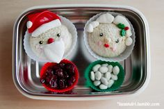 """Santa and Mrs. Claus; made from sandwich """"cupcakes"""" with various sprinkles for eyes and cheeks, marshmallow beard and hat trim for the Mr. a..."""