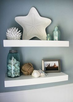 Floating shelves with sea shells... how cute for a bathroom. This easy tutorial will show you how to build these DIY floating shelves in your home. Just follow the step-by-step instructions.