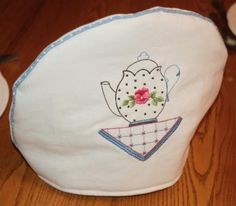 Tea Cozy -- Idea for simple embroidery on a plain background. Image only; no pattern.