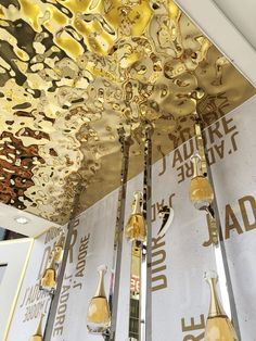 Gold color mirror finish water wave stainless ceiling for customer's event. Mirror Ceiling, Metal Ceiling, Ceiling Decor, Ceiling Design, Wall Texture Design, Steel Gate Design, Stainless Steel Screen, Metal Cladding, Gold Water