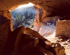 Gila Cliff Dwellings National Monument is a U. National Monument in the Gila Wilderness (The Nation's First Wilderness Area) of southwestern New Mexico. The national monument. Looking out from one of the cave dwellings. New Mexico Usa, Travel New Mexico, Rio Grande, New Mexico Tourist Attractions, State Parks, Grand Canyon, Silver City, Land Of Enchantment, Archaeological Site