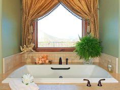 oversized sunken tub has relaxing view from window