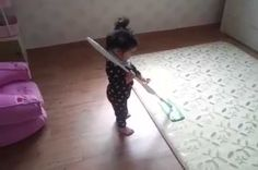 This little girl likes mopping a bit too much