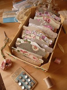 love this storage idea for lace, ribbons, trims etc - think i'll use one of my gazillion photo storage boxes covered with pretty paper and mock up the holders using chip board and modge podge