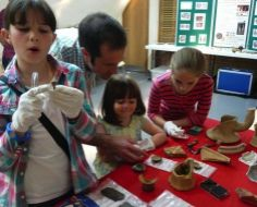 Letting them get involved with some artifacts - as long as they aren't too fragile!