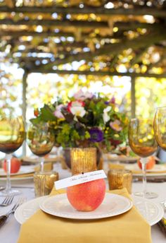 Rustic wedding table - I love the escort card pinned to the apple