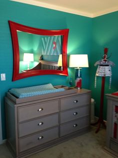 Love this mirror and color scheme for an atomic style/space boy's nursery
