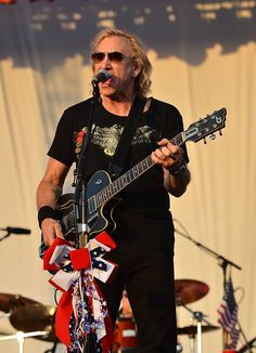"Joe Walsh, the James Gang, Barnstorm, and the Eagles. He has also experienced success both as a solo artist and prolific session musician. He holds the 54 spot in Rolling Stone magazine's ""100 Greatest Guitarists of All Time"""