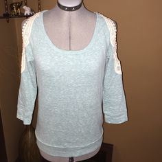 NWOT cold shoulder top❤️❤️❤️ NWOT cold shoulder top❤️❤️❤️ washed gentle, flat dried, then never wore. A little wrinkled from folding but will steam out when mailed. Super chic.. 3/4 sleeves. Teal like color and white. Soft. Great for spring. ❤️❤️❤️❤️ Maurices Tops