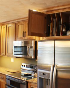 Make Use Of The Space Above Your Refrigerator For Storing Cookiesheets And  Trays. This #