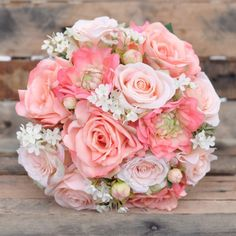Wedding bouquet made with peach roses, salmon roses, coral dahlia's and wax flower. See more here: https://www.etsy.com/listing/161866658/wedding-flowers-summer-wedding-bouquet?ref=shop_home_active_13
