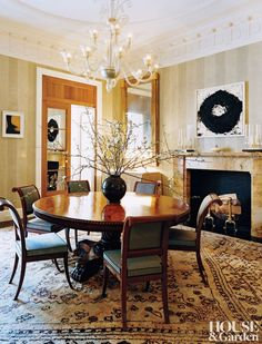 The dining room of a Manhattan townhouse designed by David Kleinberg features a 1950s Venetian chandelier, a Regency-style Anglo-Indian table, and Empire side chairs counterpoised against an untitled Richard Serra oil-stick drawing and a small Andy Warhol silkscreen, at left.  ARCHITECT: Nasser Nakib Architect DESIGNER: David Kleinberg Design Associates PHOTOGRAPHER: Thomas Loof