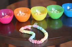 Kid Activities & Kid Crafts - Cereal Necklaces. Make necklaces out of cereal for a snack later!
