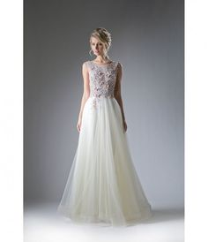 You are the kind of gal who loves fairytale gardens and mystical creatures. Why not find a prom dress that matches your unique self? Our embellished ivory chiffon is perfect for your prom needs! This magical gown has a beautiful sleeveless jewel cut bodic