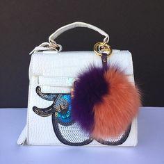ea7eedbb0c5 Duo orange purple fox fur Pom Pom bag charm  furpompomkeychain   furbagcharms… Pom Pom