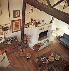 Dream Living Room: Adobe Fireplace, Hardwood Floors, Exposed Wood Beams, Modern Decor, Guitar