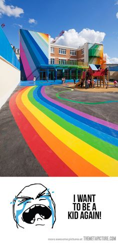 A Kindergarten Building Covered In Rainbows! Okay not really a Home but a building, still amazing, i love this!