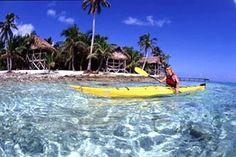 Sea kayaking Belize at Glovers Reef Atoll.