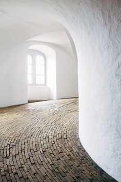Ascending the 400 year old Rundetårn in Copenhagen.