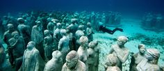 An eerie sense of community is captured in this #Underwater_Sculpture by #Jason_deCaires_Taylor.