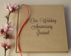 Our Bucket List · Custom First Wedding Anniversary Gift · Our Happily   Ever After Personalized Anniversary Journal · Paper Anniversary Gift.   We   love how these just fly off the shelf! Get yours today for $29 and find   out what all the bustle is about. We hand craft each one right here in   house. They lay open flat for comfortable, sturdy use.  EASY to order.