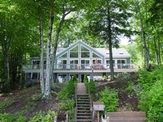 Waterfront Lake Winnipesaukee home that sleeps 10.  Built on a sandy beach with a dock, this home with a game room and screened porch is perfect for vacation | Lake Winnipesaukee Rentals