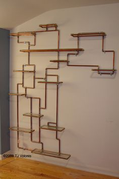 Copper pipe shelves... I'd spray paint them but cool idea