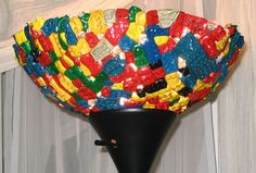 This awesome lampshade, picked as one of Craftster's best of of 2007 projects, was created by baking the LEGO bricks in a round cake pan in the oven.