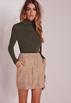 For a sleek finish to your look, invest in this khaki long sleeve bodysuit. This transitional piece in our favourite hue features a turtle neck for a new season update and is perfect for bringing together a minimalist look. Team with a faux...
