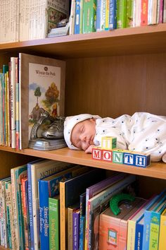This is a cute baby picture, but I would be way too paranoid to EVER stick my baby on a shelf. Ever.
