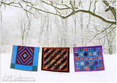 Amish quilts on clothesline in winter