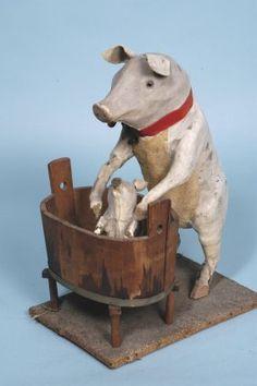 Mother pig gives her piglet a bath - antique wood figure