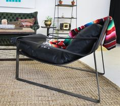 Our black leather Rock House chair featured in our Capricorn Zodiac Style lounge | Patina