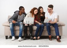 Multiethnic young students study with gadgets, preparing for exam, sitting on sofa in living room, studio shot Student Studying, Studio Shoot, Mom Jeans, Gadgets, Students, Sofa, Living Room, Settee, Home Living Room