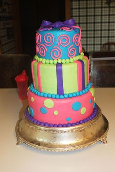 Marissa's bridal shower cake. Trying to fit her tie dye wedding color theme.