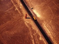 Lines in the Sand by Cezary Filew; the Pan American Highway cuts a modern path past some of Peru's ancient Nasca lines, Peru