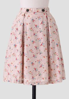 Beautifully crafted in beige cotton, this darling midi skirt is adorned with a colorful floral and polka dot print medley. Accented with decorative buttons and box pleats at the front, this volum...
