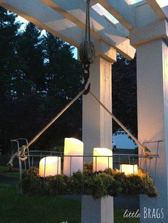 Hang a wire basket, add moss and Mirage outdoor LED flameless candles with the timer on for an easy outdoor chandelier.